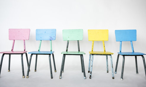 Colorful chair is on a row.