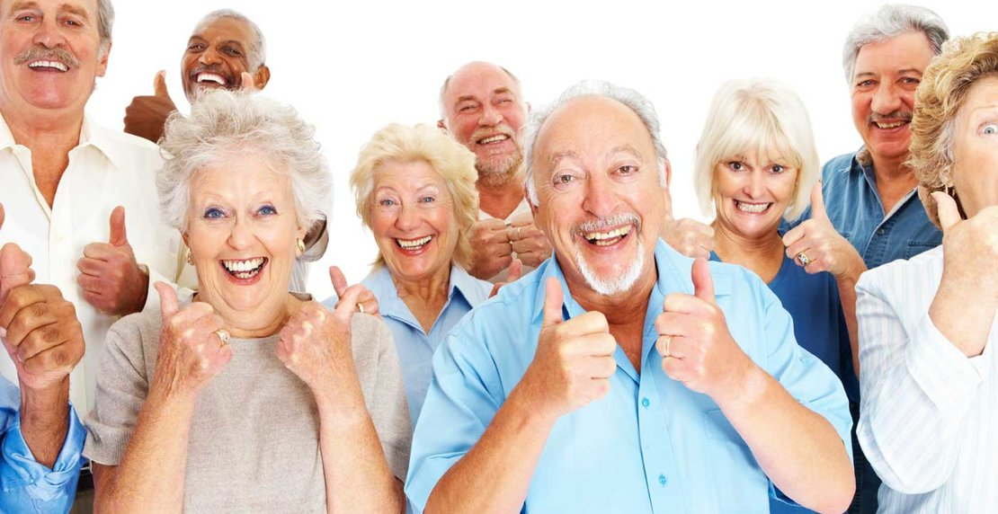 Group of retired people showing the success sign
