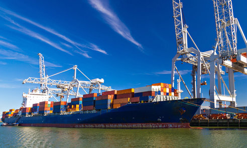 Large,Container,Vessel,Unloaded,In,Port,Of,Rotterdam